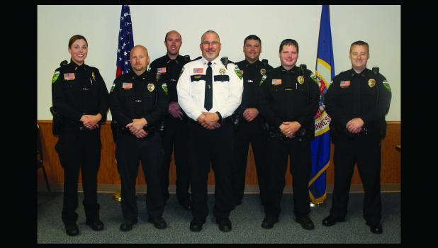 Springfield police officers posed for a picture following a staff meeting on October 1.  Officers Valerie Hauser, Justin Robertson, Chief John Nicholson, Officers Joe Micha and Eric Gratz.   At back are part-time Officers Michael Gordon and Andy Mathwig.