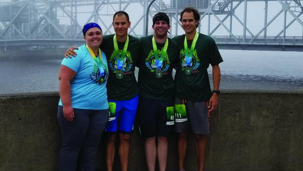 Leah Larson, Andrew Nachreiner, Anthony Roiger and Dylan Nachreiner posed for a picture with the Duluth drawbridge in the background.