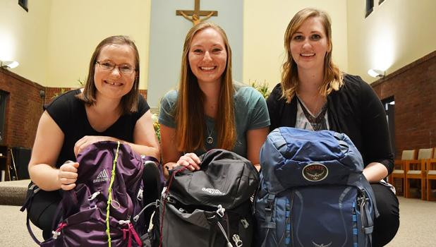 Anne Goedtke, Erin Hauth and Rebecca Goeman are pictured as they prepared for pilgrimage in Spain.