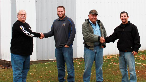 Braun and Borth Sanitation will switch hands Jan. 1, 2015. Pictured from left, current owner Barney Borth, new owner Brent Kucera, current owner Mike Braun and new owner Chad Mathiowetz.