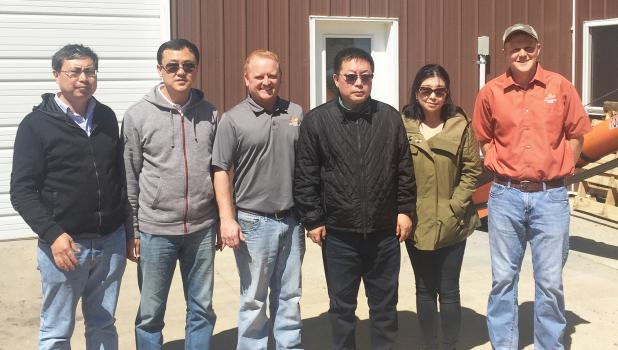 Chinese visitors at Jack Larson Seeds — at the center of the picture is Yu Yong, executive director and president of Zonergy.  Second from left is Eugene Kremener of Brazil, Agro representative / director of North America and South America.    Johnny Larson is third from left.  Evan VanDerWal is at the right.