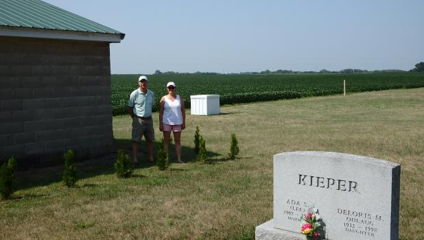 Roger and Julie Prechel planted the new Emerald Arborvitae at the City Cemetery.  The new shrubs were a gift given to the Association's Tree Fund.