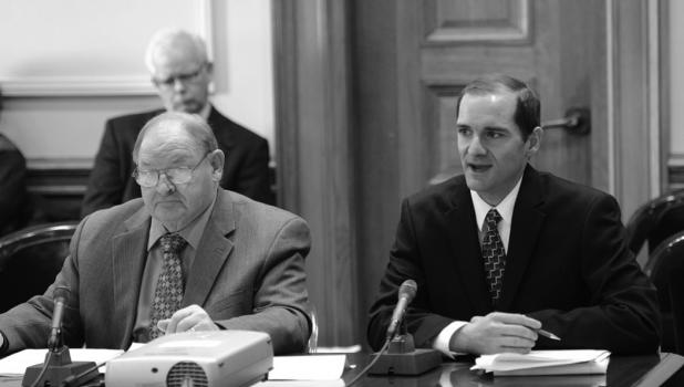 Senator Gary Dahms (R – Redwood Falls, left) and Springfield City Manager Matt Skaret testify before a Senate committee on Senator Dahms' workforce housing bill.