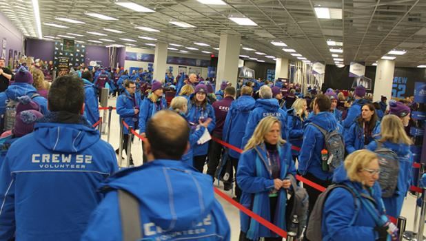 "Crew 52 in Blue Jackets at Super Bowl Live volunteer headquarters as they arrived for a shift."" The logistics of getting that many volunteers in the right place in itself was remarkable. They fed us Schwan's soup and snacks when we got done with a shift,"" Olson said.  ""It took a crew of 50 volunteers just to take care of the volunteers."