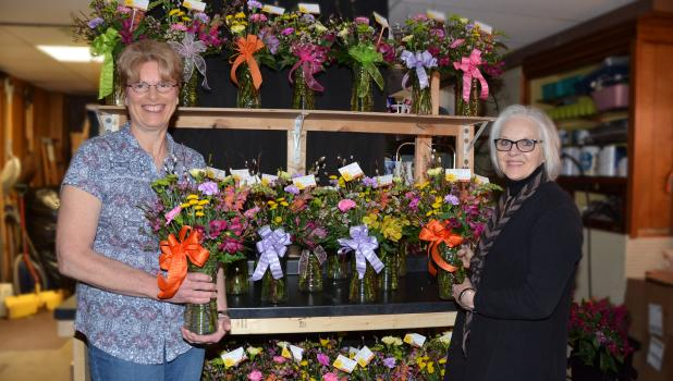 Tammy Kieper, on the left, is pictured with Char Frank of Springfield Floral with some of the bouquets that were delivered last Thursday and Friday.