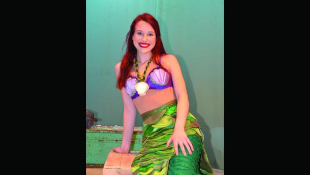Ariel ponders life above the sea in Disney's The Little Mermaid going on stage November 22-24.  Grace Pingeon is cast as Ariel in the  musical production in the Performing Arts Center at Springfield Public School.