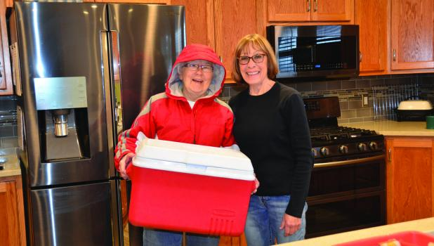 Diane Johnson is pictured with one of her volunteer drivers Fran Schmitz.
