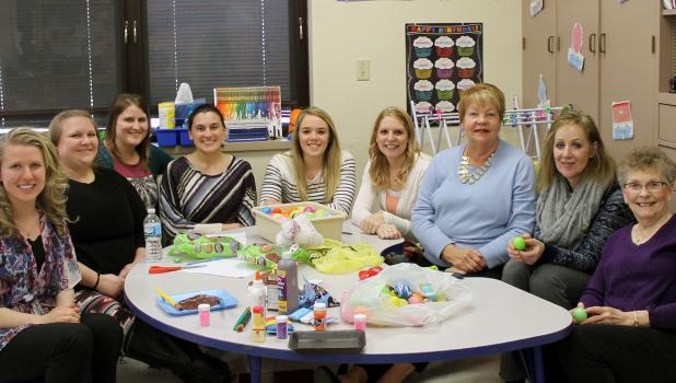 Springfield School District's Early Childhood Learning Staff photographed recently during a recent work session as they prepared for an activity — from left:  Whitney Sperry, Mandi Kuehn, Amber Vogel, Melonie Heiling, Courtney Schmidtt, Bianna Jensen, Jan Simonsen, Julie Hoek and Sharon Ferdinandt.
