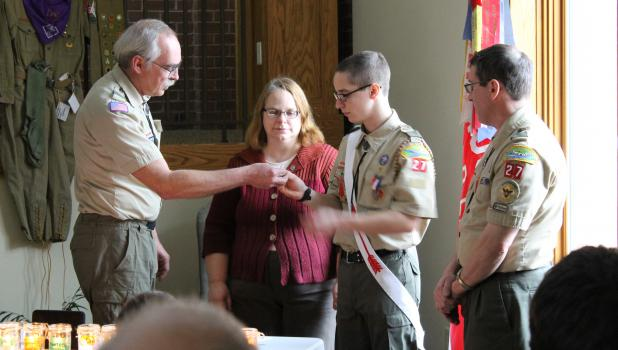 Ken Moe presents Andrew Hoffmann with his Eagle Scout medal during the Eagle Court of Honor Sunday afternoon. Andrew's parents, Mary Beth and Lynn Hoffmann, are pictured with them.