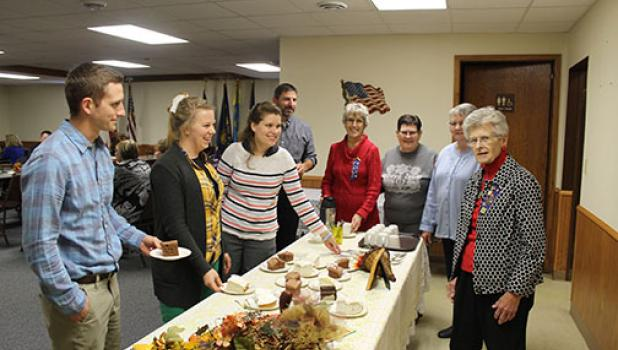 Educators pictured at the refreshment table are Luke Amsden, Beth Weingart,  Deanna Forry and Todd Bertram, and Auxiliary Past Presidents doing the serving are Arliss Petersen, Cindy Schnobrich, Cheryl Haala and Dalores Stern.