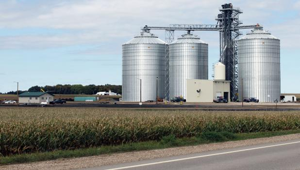 Farmward Cooperative's new grain receiving facility provides capacity for storing 840,000 bushels of grain in three different storage bins. The site provides ground pile storage for 1.5 million bushels of grain; facility also has a corn dryer with capacity of 4,000 bushels per hour.