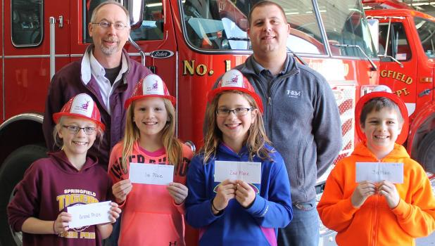 Contest winners who received cash prizes, pictured, from left are Skyla Dauer, grand champion; Samantha Walter, first; Emma Hauger, second; and Talan Hall, third. They are students at Springfield Public School. At back are F&M Insurance Agents Roger Prechel and Ramsey Beyer.