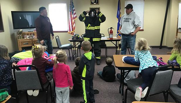 Firemen Joel Pingeon, Victor Thatcher and Dale Knutson showed the children around the fire station, fire trucks, their equipmet and had a good discussion with the preschoolers about fire safety.
