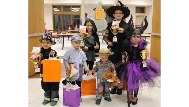 Harvest Fun Night Costume Contest Winners announced  Children dressed in Halloween costumes of all types for the annual contest held during Harvest Fun Night at the Springfield Area Community Center.  Winners from  left Tiago Linan, age 5-8; Kendal Beyer, age 0-4; Gabby Anderson, age 9-12; Evan Moody, age 0-4; Jack Scheitel, age 9-12; and Jaylin Brown, age 5-8.