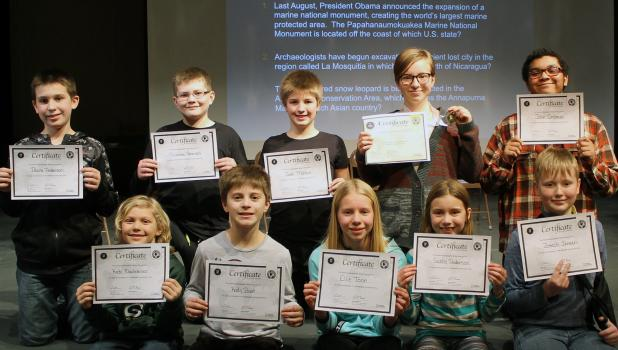 Top scorers at Springfield Public School competed in the local level of National Geography Bee competition Friday — front, from left: Kade Nachreiner, Kody Bast, Ellie Tonn, Gabby Anderson and Joseph Jensen. Back: Blaine Anderson, Nicholas Peterson, Josh Moldan, Champion Libby Tonn, and John Ombaye.