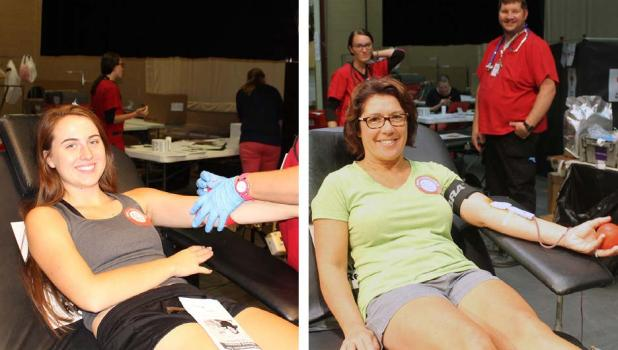 Callie Wersal and Andrea Erickson give blood at the blood drive hosted by Springfield High School Honor Society.