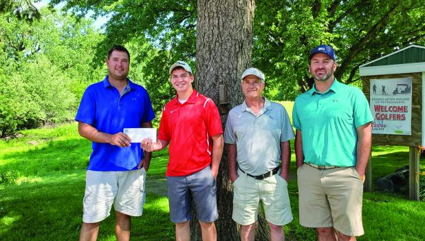 Tournament winner Mason Kretsch is being congratulated by Mason Fredin, President of the Board of Directors of the Springfield Golf Course, along with Roger Larsen and Greg Hillesheim.