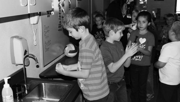 """First graders used """"Glow Gel"""" to see the germs left behind."""