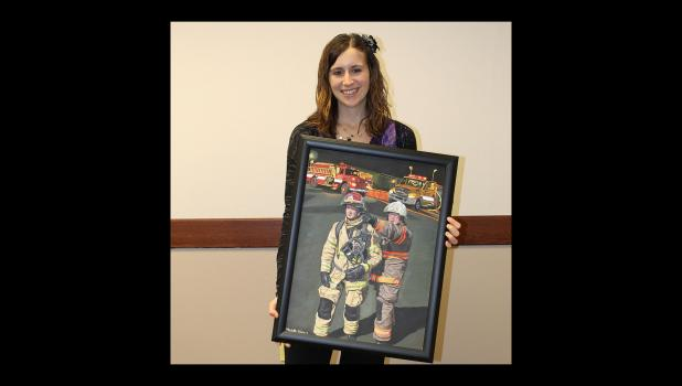 "Michelle Adrian shows the painting, ""Following a Father's Footsteps in the Flames."""