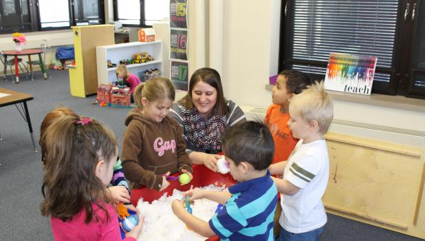 Preschool programs are filled with investigation, exploration, and discovery, where active and enthusiastic children can refine and expand their skills and knowledge. Amber Kretsch is pictured with Tiger Cubs preschoolers as they play and learn.
