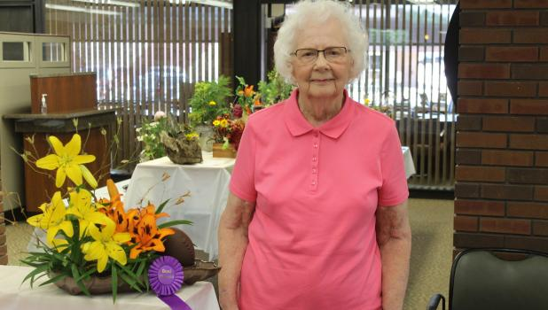 Betty Trudeau with her prize-winning arrangement of lilies in the Garden Study Club's Flower Show Friday, June 24.