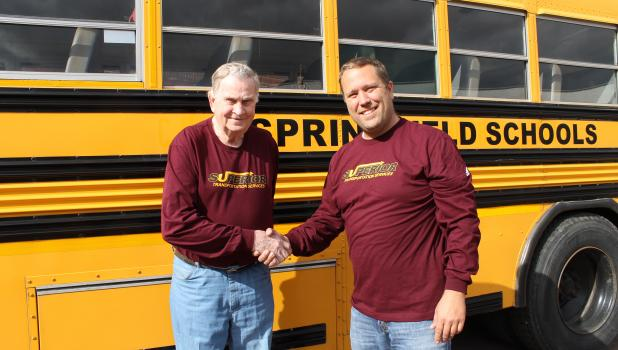 Delmar Nelson receives thanks and appreciation for his many years driving school bus from bus service owner Joe Schieffert.