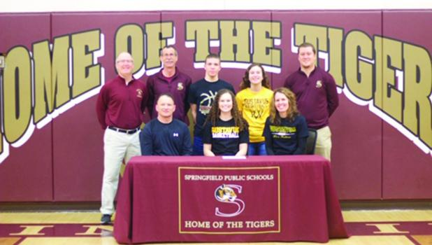 Pictured with Sydney are her parents, Mark and Denise Hauger. She was also joined by Paul Arnoldi Activities Director – Springfield Public School, Mike Kelly-Assistant girls basketball coach, her brother Caleb Hauger, her sister Emma Hauger, and Tigers Girls Basketball Head Coach Dillon Schultz.