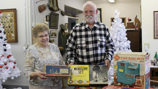 Bill Ochs and Springfield Area Historical Society board member Carole Young are pictured with the toys.