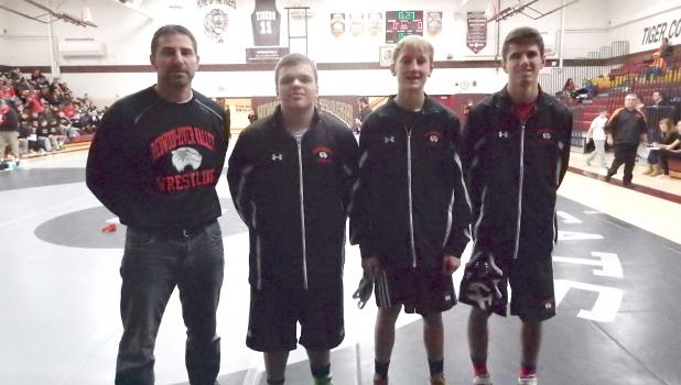Redwood-River Valley Badger Head Coach Todd Bertram pictured with three wrestlers from Springfield; Nathaniel Rosado, Devin Johnson, and Conner Bertram. The wrestlers all placed a the Badger Tourney last Saturday in Springfield