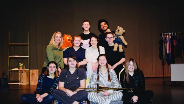 Front Row L-Kaylynn Sanderville, Sydne Wahl, Sara Kottke and Kiera Lafferty.  Middle row: Director Gabby Cohrs-Rohlick, Alexis Clemon, Grace Pingeon and Isaac Rasset. Back Row: Jace Rosenau, and John Ombaye.