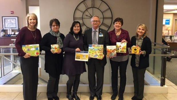 On National Winnie the Pooh Day, Jan. 18, Julie Smith, Shelly Anderson, Cindy Hillesheim, Kathy Hillesheim and Laurie Gewerth presented games and books for the pediatric department at Mayo Clinic Health System in Springfield. The bankers are pictured with Hospital Administrator Scott Thoreson. Another #rakbyFMB!