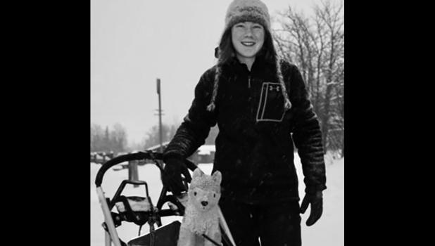 Lara Renner, 15, carried her dad's old stuffed husky around on her sled as she prepared for the race.