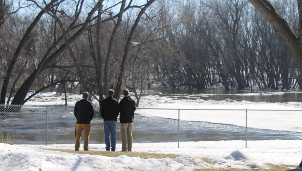 Springfield City manager Joe Stremcha, Emergency Management Director Scott Johnson, and City Engineer Bill Helget, of Bolton and Menk, watch as huge chunks of ice and a floe break free on the Big Cottonwood River and move downstream the afternoon of March 20.