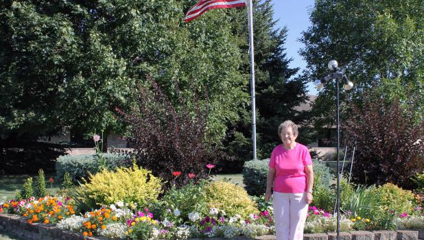 Rose Lee cares for the garden at Riverview Homestead Housing.