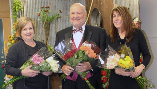 Rotarians pictured as they  prepared for flower delivery are Kahla Petersen, John Fank and Sharon Pieschel.
