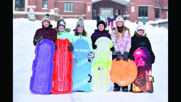 The sixth grade class  paused for a photo during their last Catholic Schools Week at St. Raphael during their sledding activity. (From left) Leo Hovland, Olivia Milbrath, Jada Reese, Zoie Riederer, Addision Lang, Kameron Bigelow.
