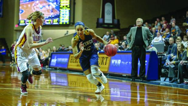 #12 Vishe Rabb brings the ball down the court for the Lady Vikings of Augustana University last year.  She is looking forward to upcoming college year and season.