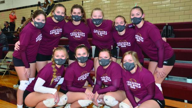 Springfield Volleyball team members pose for a photo in there COVID Style t-shirts before a game early in the season. Pictured Front Row (Left to Right): Maddy Digmann, Jaeli Richert, Tori Roiger, Iliana Tempel. Back Row (Left to Right): Bree Rasmussen, Haley Runck, Cylee Graff, Courtney Wendt, Brooklyn Sturm, Lexie Groebner. Not Pictured: Anna Mattson