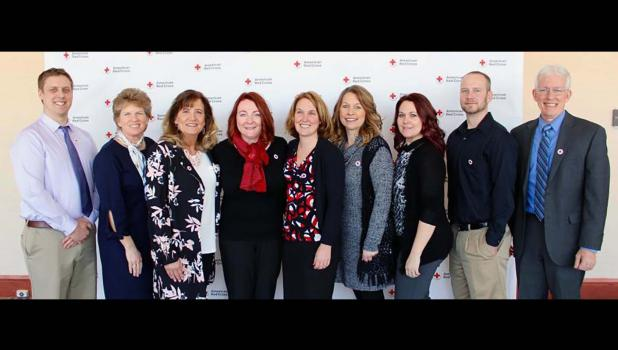 Organ donors honored on March 8 with Heroes in the Heartland award from American Red Cross at Nebraska Medicine, Omaha — pictured from left: Ben Little, Kelly Mogler, Sue Venteicher; Vicki Hunter, kidney/pancreas transplant manager; Gina Rau, transplant coordinator; Jennifer Baer, Nikki Quakenbush, Derek Beisner, and David Hansen.