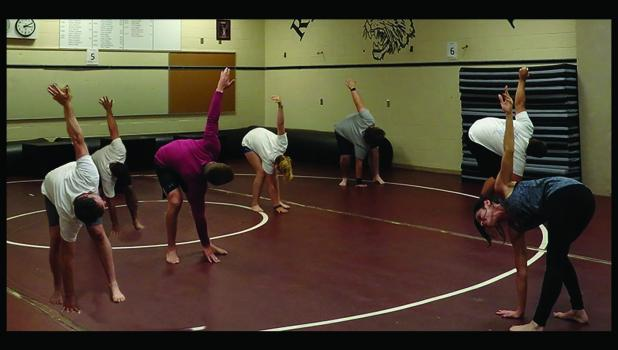 Traci Zuhlsdorf instructing a yoga class at Springfield Public School.
