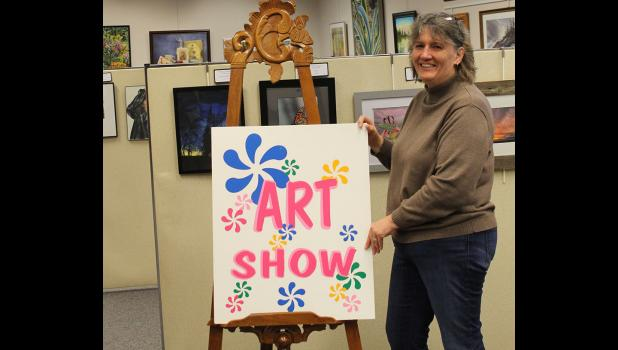 "Library Director Linda Roiger puts out the ""welcome sign"" 