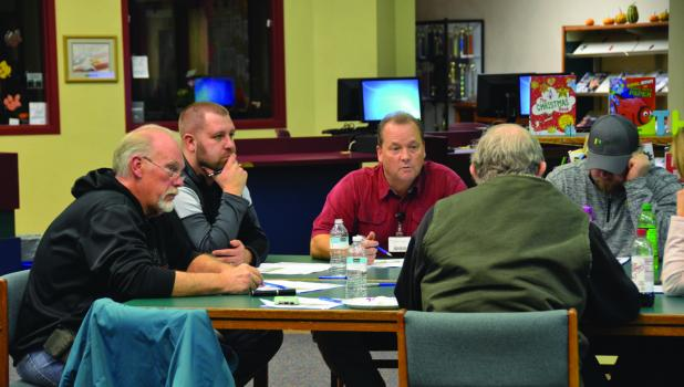 Members of the Springfield School District Facility Task Force discuss the survey results on the evening of Nov. 20.