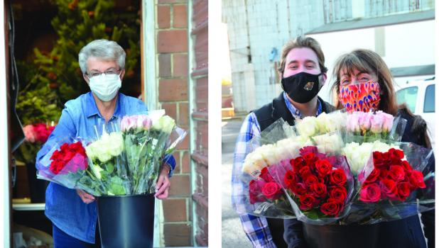 Sharon Sturm, Joe Stremcha and Sharon Pieschel deliver roses for the Rotary Rose fundraiser.