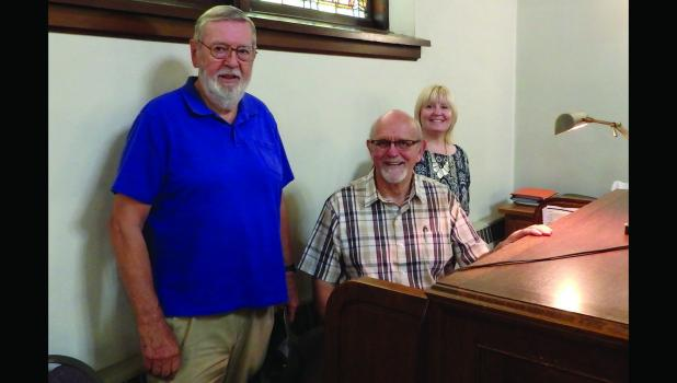 Pictured around the organ are, from left:  Rev. Al Negstad, Rev. Tom von Fischer and Rev. Tricia Mattson,  current pastor at St. Paul Lutheran Church.