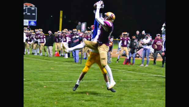 Jordan Toll catches a Buerkle 11 yard touchdown pass in the third quarter of last Friday's home win against Adrian.