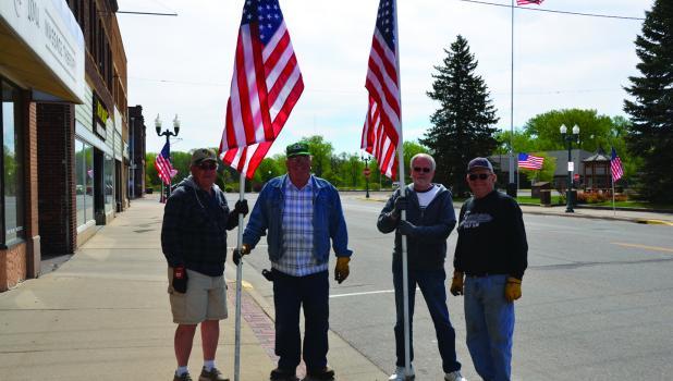 John Watson Post 257 American Legion members Ken Koll, Floyd Rogotzke, Doug Wenisch and John Ryan were seen placing flags on Central Street this past Friday.
