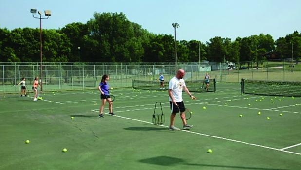 Coach Andrews leading tennis practice.