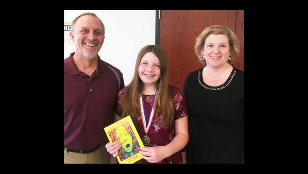 Kiera Lafferty with her teachers,  Troy and Darcy Hoyt.