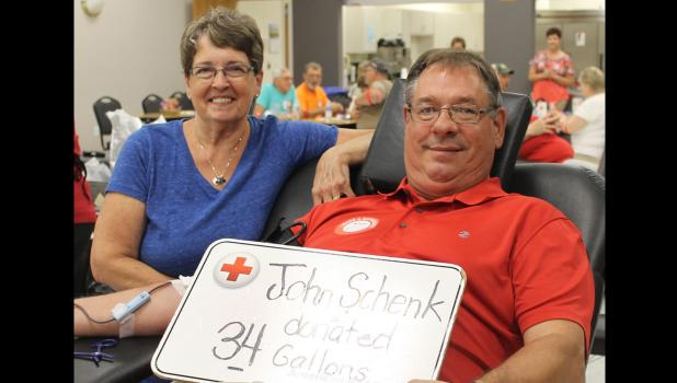 John Schenk gave his 34th gallon of blood June 18, when the Red Cross Bloodmobile was in Springfield. His sister, Jean Kitzmann of Sioux City, Iowa, came to congratulate him and also rolled up her sleeve and gave blood.