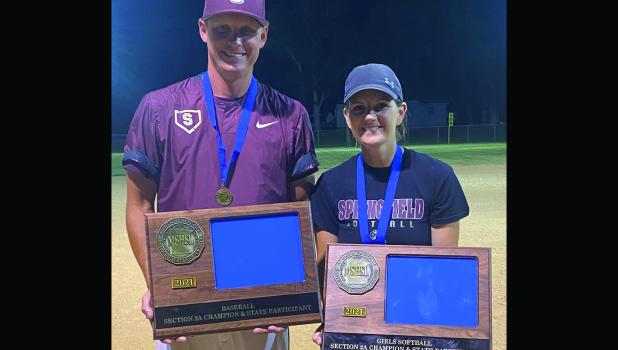 Brandon and Katie Wilhelmi with the 2021 baseball and softball Section Championship trophies.